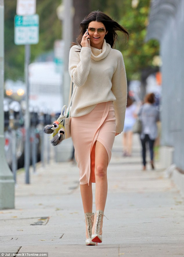 Happy day: Kim Kardashian's half-sister kept up the banter over the cell phone on the way to the deli