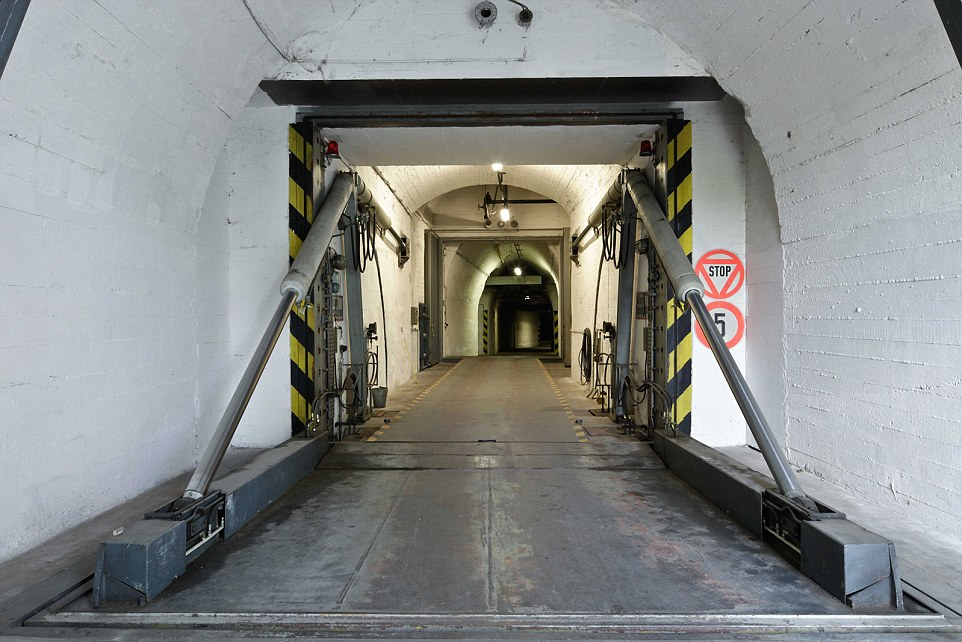 Secure: The survival bunker can apparently withstand a nuclear blast, chemical agents, earthquakes, tsunamis - and virtually any other disaster. Above, this photo shows a drive-thru blast-proof door at the complex, which will likely be available only to the super-rich