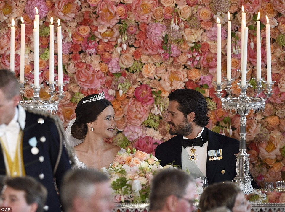Happy couple: The newlywed royal couple gazed lovingly into each other's eyes over the dinner table following their star-studded wedding ceremony