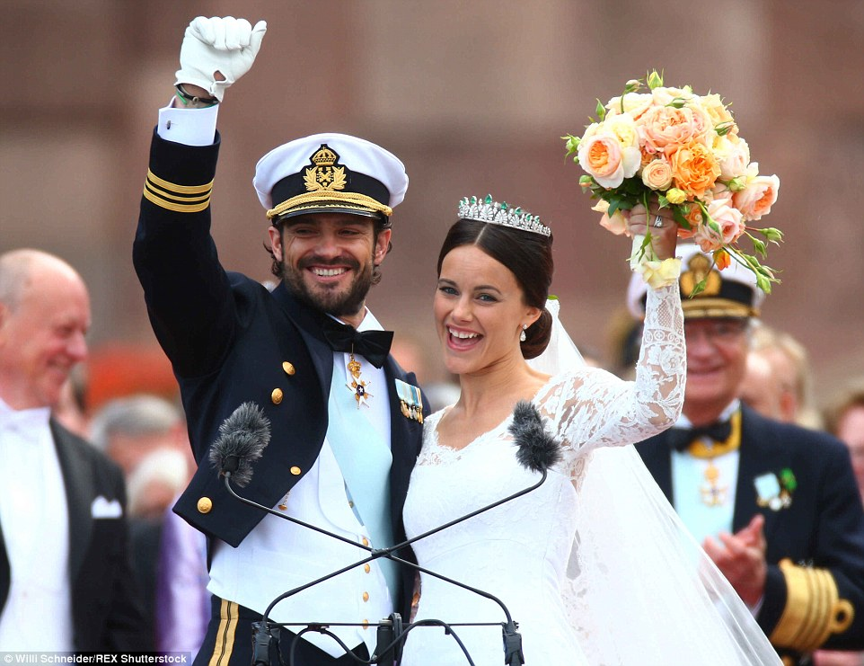 Celebration: The newlyweds beamed with happiness as they shared their first moments of married life with well-wishers gathered outside