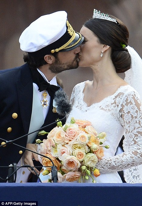 Stealing a kiss: The prince can't resist leaning in