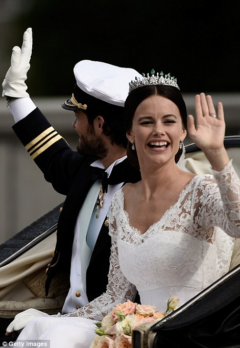 Newlyweds: Princess Sofia waves as they ride away from the chapel