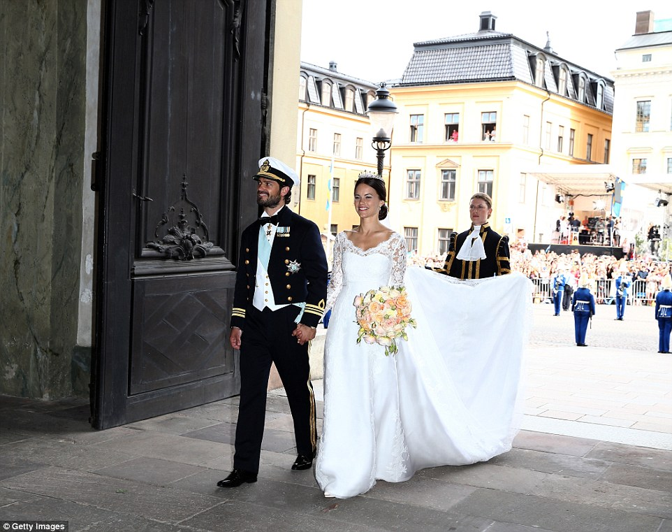 Breathtaking: Prince Carl Philip and his beautiful bride, Princess Sofia, leave their wedding to the cheers of waiting crowds