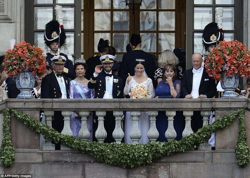 The couple were joined bySweden's King Carl XVI Gustaf and  Queen Silvia (left) and the bride's parents Marie Hellqvist and Erik Hellqvist