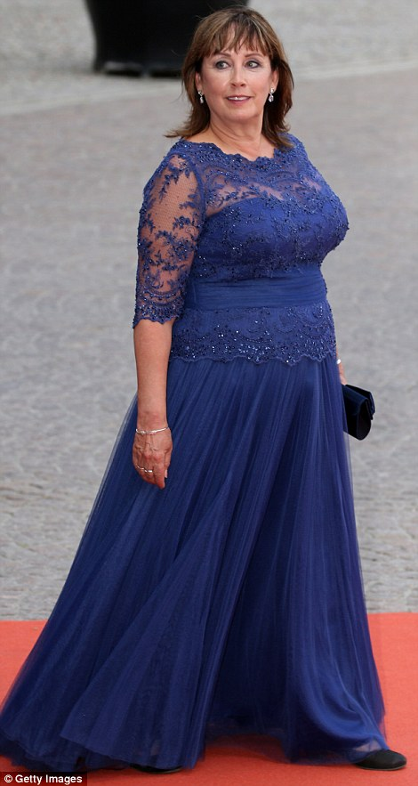 Mother of the bride Sofia Hellqvist wore a sweeping royal blue gown