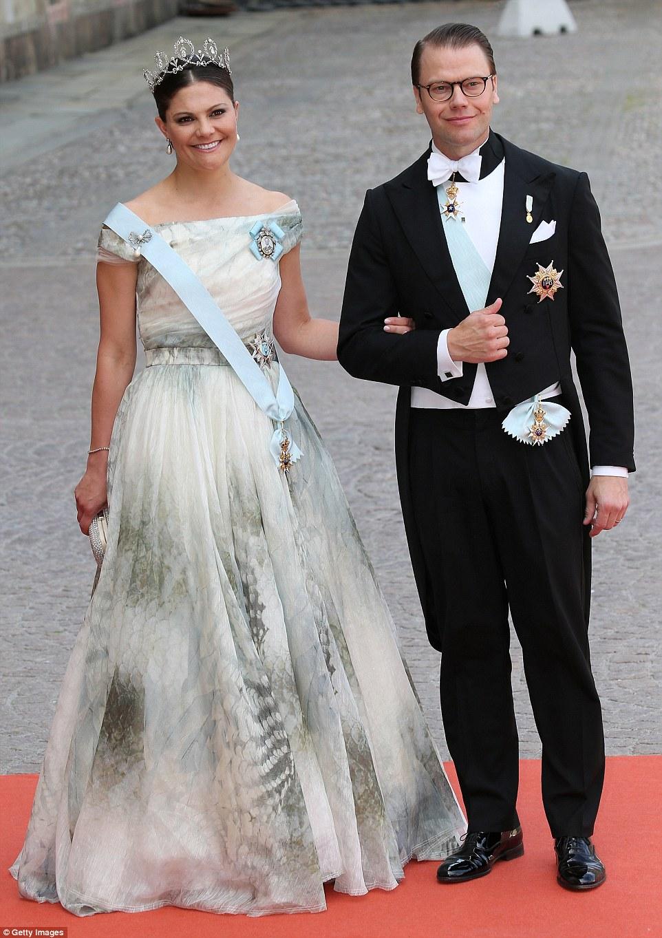 Carl Philip's eldest sister, Crown Princess Victoria of Sweden, and her husband Prince Daniel of Sweden smile for the camera