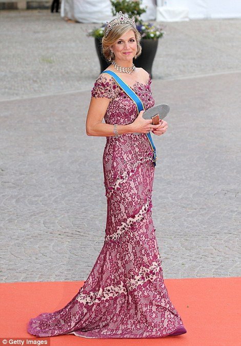 Queen Maxima of the Netherlands looks radiant as she makes her way into the Stockholm Royal Palace for today's wedding