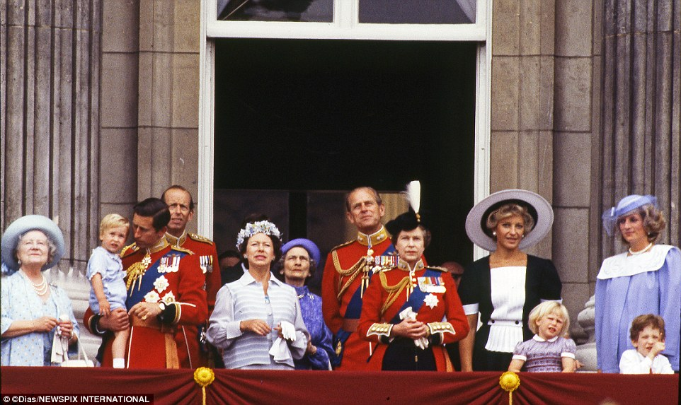 How times change: The royal family pictured 31 years ago as Prince William was taken on to the balcony for the first time during the Trooping of the Colour while being held by father Prince Charles (left)