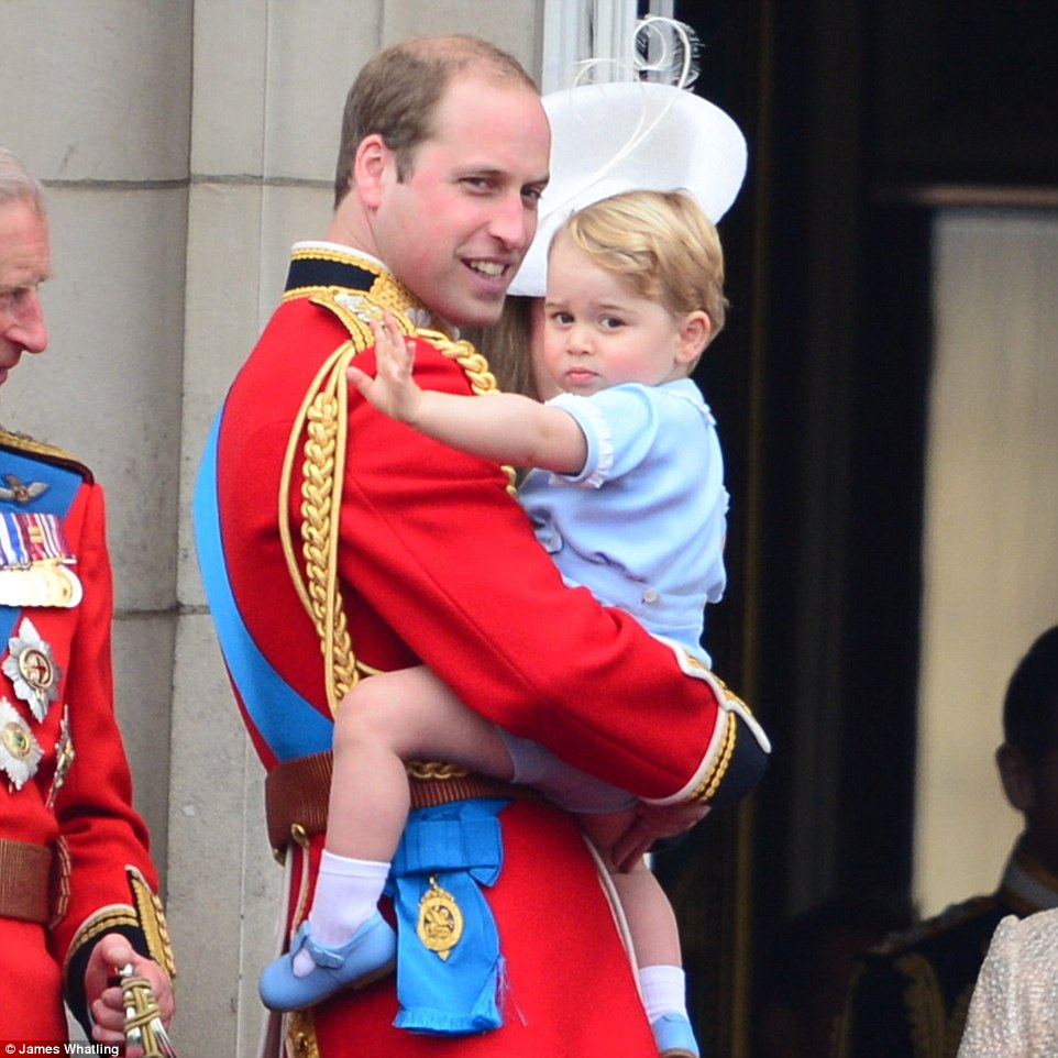 Prince George waves to the crowds at the Trooping the Colour parade during his first appearance on the Buckingham Palace balcony