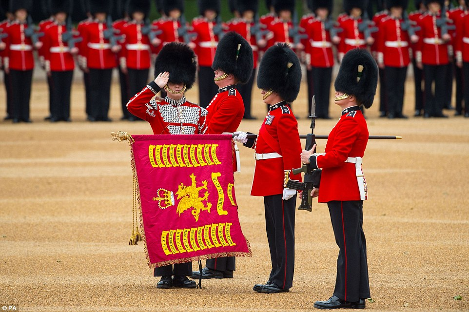 Troops of the Welsh Guards present the Colour standard during Trooping the Colour at Horse Guards Parade in London today