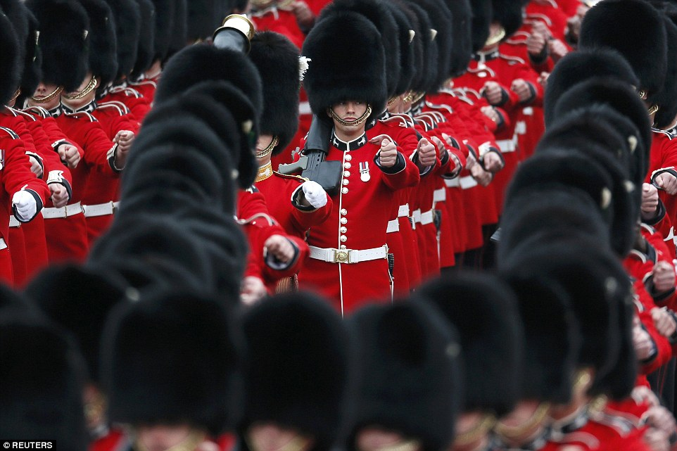 Guardsmen march past Buckingham Palace before the Trooping the Colour ceremony at Horse Guards Parade in central London