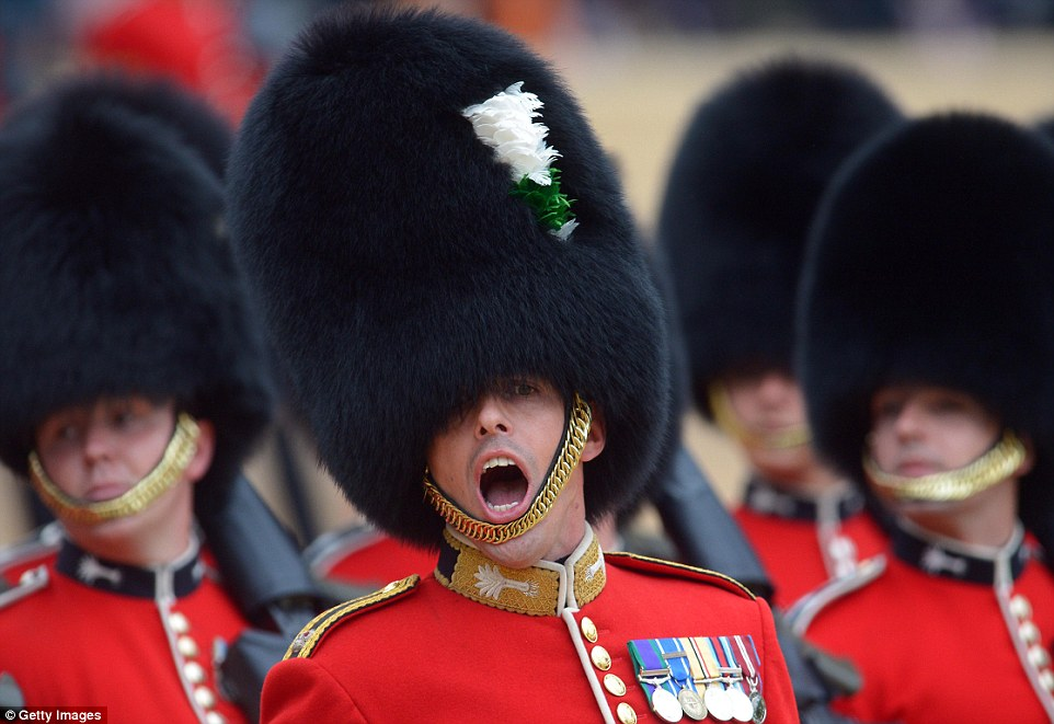 Members of the Welsh Guards march past the Queen while taking part in the Trooping of the Colour parade in London earlier today