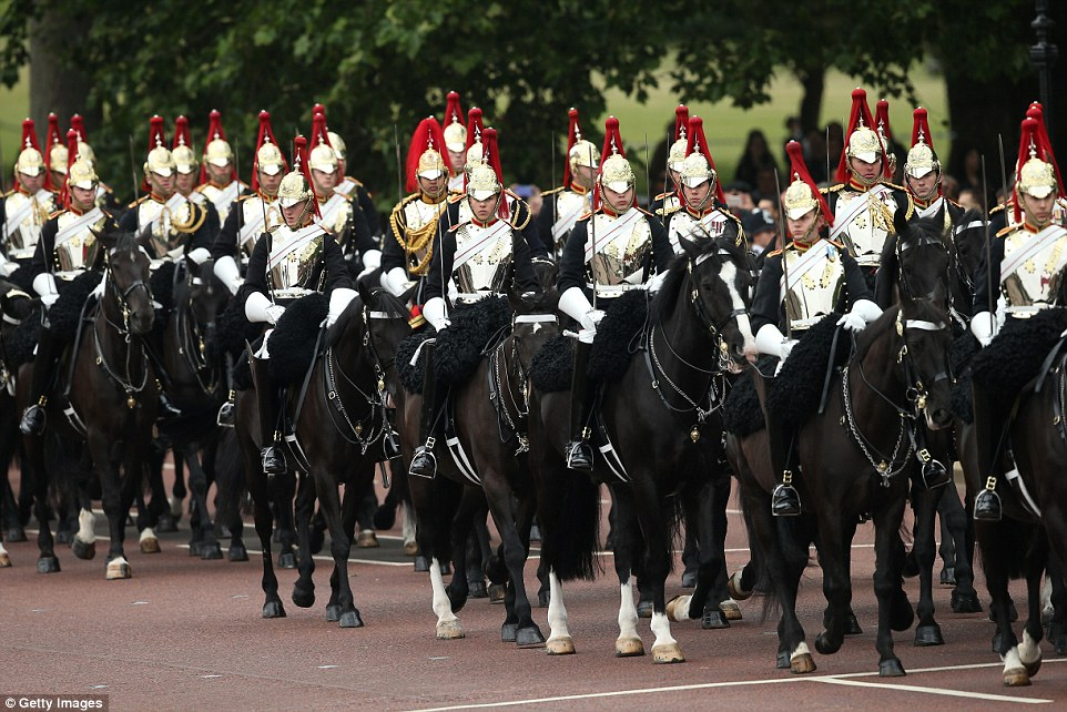 Members of the Household Cavalry Mounted Regiment take up postition on The Mall prior to the Trooping The Colour ceremony