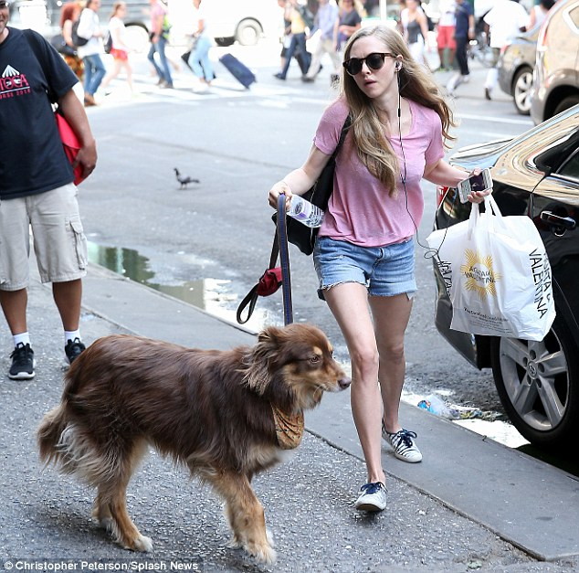 Inseparable: Amanda Seyfried escorted her beloved dog Finn to the Second Stage Theater in Manhattan on Saturday