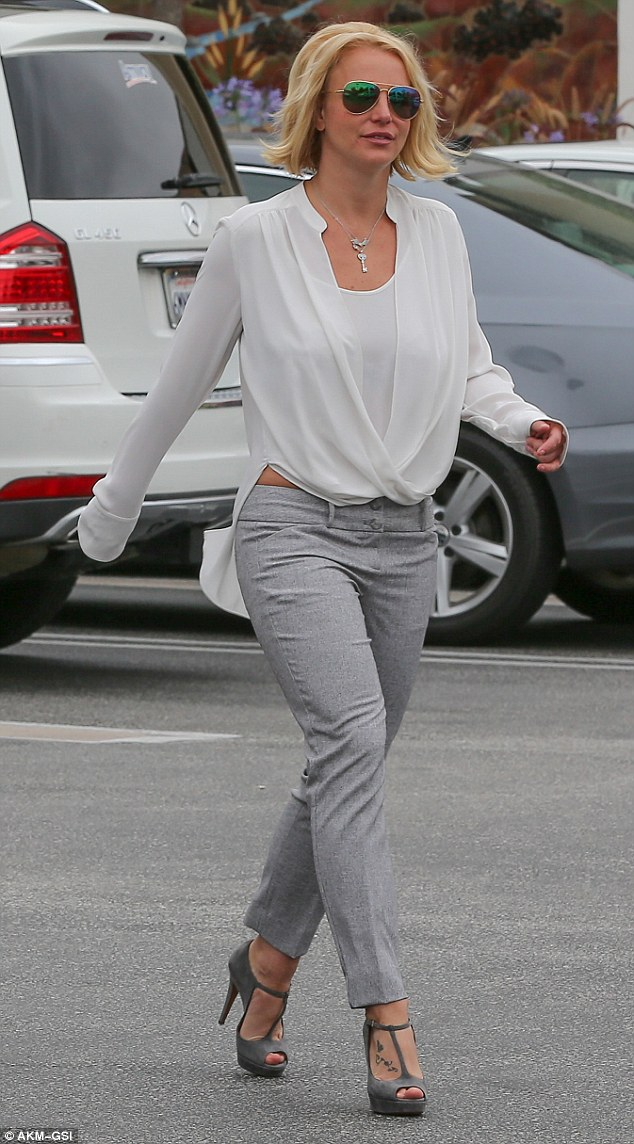Tailored look: Britney Spears was dressed neatly when she went out for coffee on Saturday morning in the Westwood neighbourhood of Los Angeles