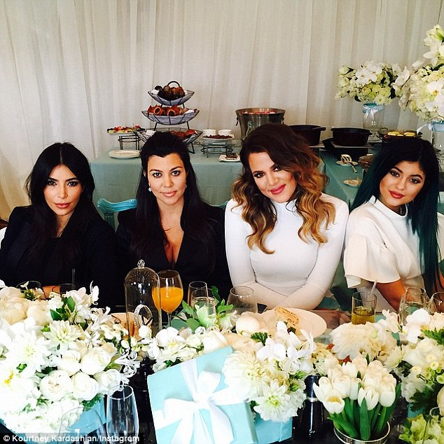 They mean business: Kim with sisters Kourtney, Khloe and Kylie Jenner at an industry luncheon