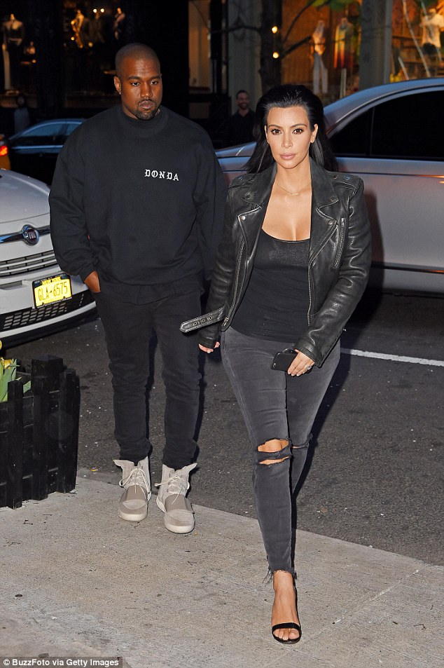 Donda: Kanye and wife Kim Kardashian get dinner last month in new York. Kanye is seen wearing his clothing company Donda