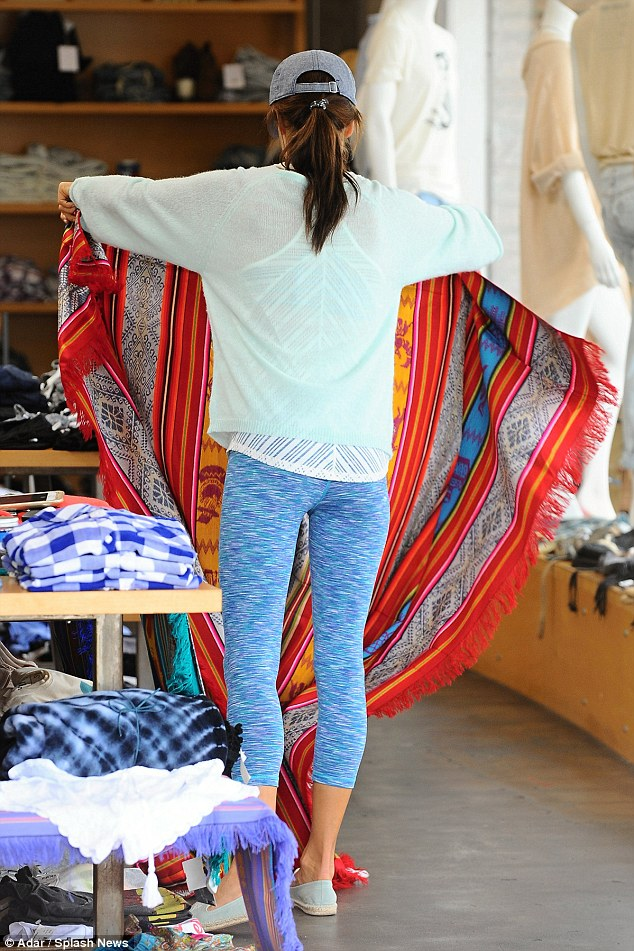 Pert: The model popped into the Planet Blue boutique, which co-incidentally carries her retail collection, Ále by Alessandra
