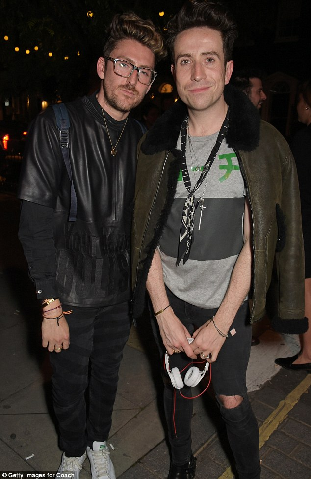Fashionable friends: Nick posed with friend Henry Holland outside the venue on Saturday night