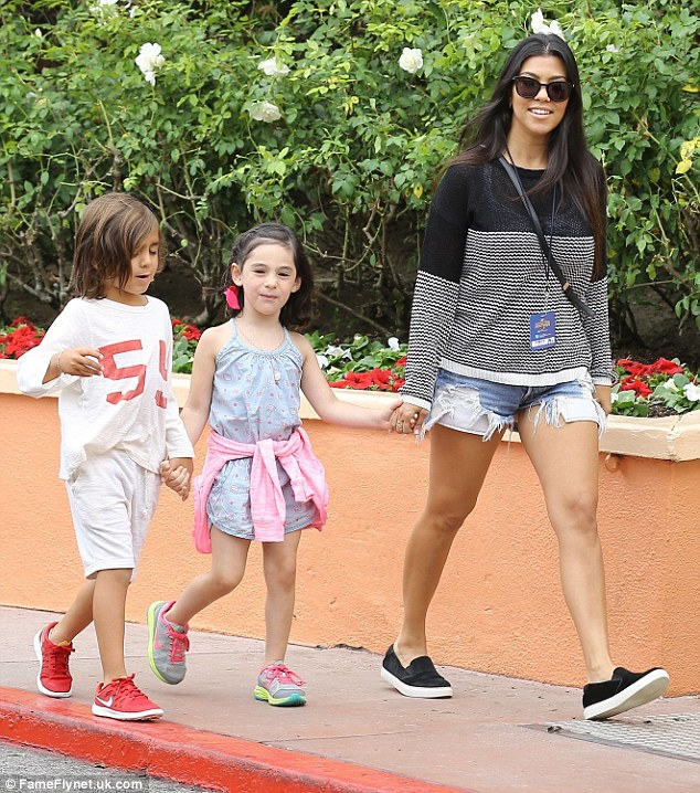 Keeping up with the kids: The 36-year-old mum of three led Mason, five, and his young pal, into the Universal Studios lot
