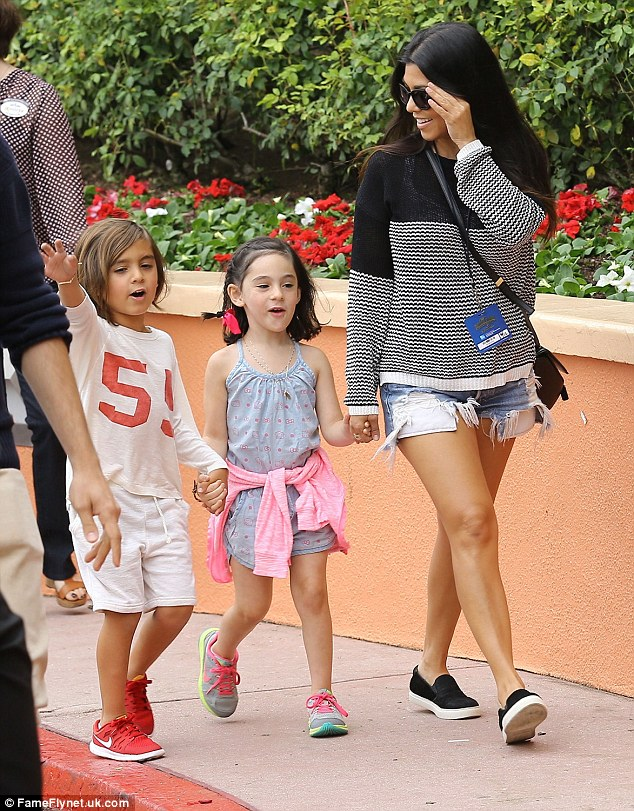 Excited: Little Mason - Kourtney's oldest child - looked thrilled as he chatted to his mum and female friend on their way in