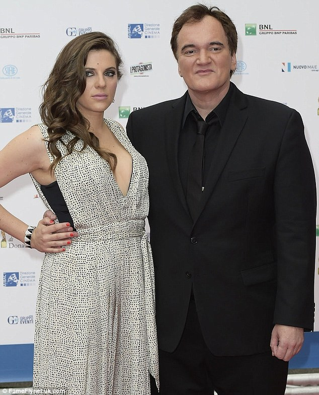 Daring: Quentin Tarantino's girlfriend Courtney Hoffman, 30, wore a plunging dress as they arrived at an Italian film festival on Friday