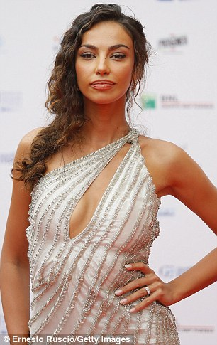Dazzling:Romanian actress Madalina Ghenea, 26, showed off her slender figure in a one-strap silver dress