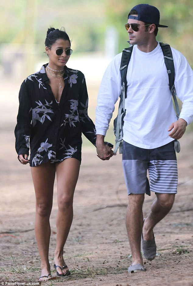 Handsy:Last month, the Hairspray star was seen walking on the beach and holding hands with his model girlfriend, Sami Miro
