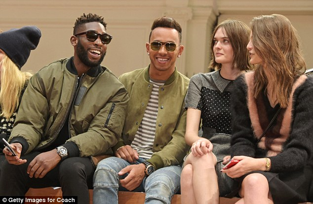 Famous friends:Sitting shoulder to shoulder, Lewis and Tinie were dressed in similar outfits, both opting for zip-up green bomber jackets and covering their eyes with black sun glasses