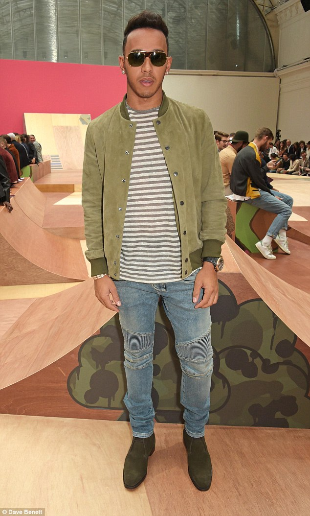 Dashing in Olive:Looking fresh the racing star opted for a grey and white striped T-shirt and coordinated his jacket with olive suede boots