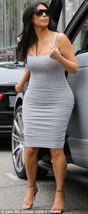 Grey day: The reality star chose a very tight-fitting ensemble as she stepped out on a cloudy day in LA