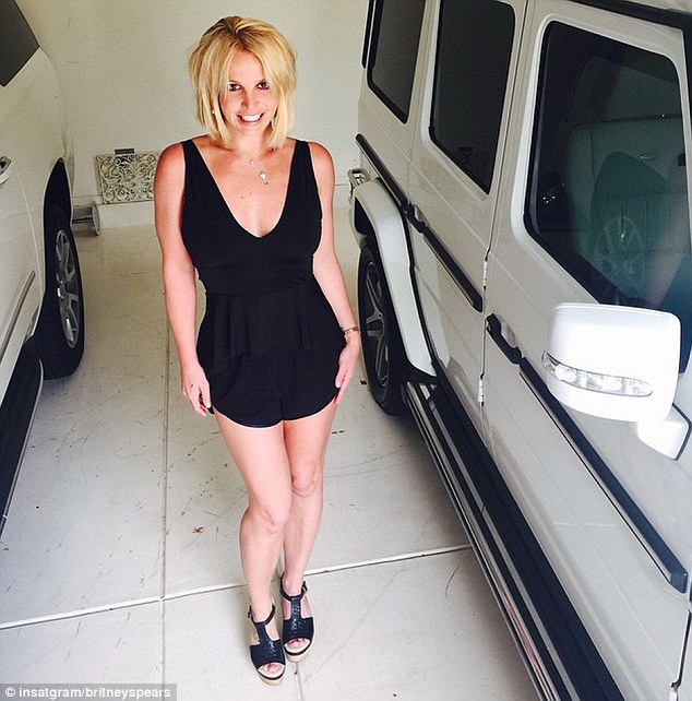 She looks good and she knows it:The Oops... I Did It Again! songbird has been showing off her body with regularity lately. On Wednesday the Southern charmer posted a snap of her lean legs in a plunging top and short shorts as she stood in her garage between two white cars
