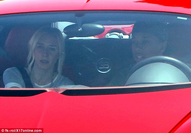 That's not Kylie! Jenner's 'boyfriend' Tyga was spotted taking a joy ride in a Bugatti alongside a mystery blonde on Friday
