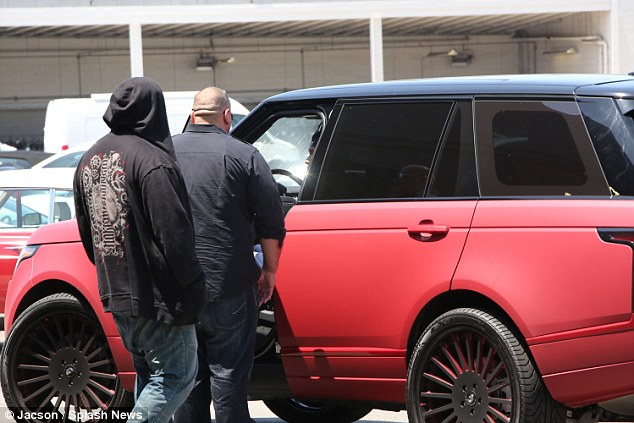 Heading home: Following the test drive Tyga was seen returning to his matte red Range Rover