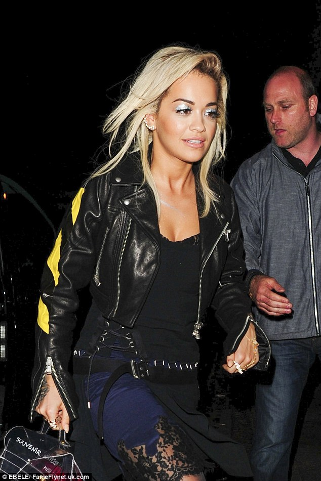 Grungy lady: Rita wore a biker jacket with a black and yellow police tape style stripe on the arm, platform boots and a grungy LBD, which was adorned with lace inserts and hooked together with silver rings
