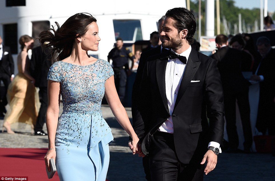 Romantic: The pair exchange smiles as they make their way onto the M/S Stockholm for a party