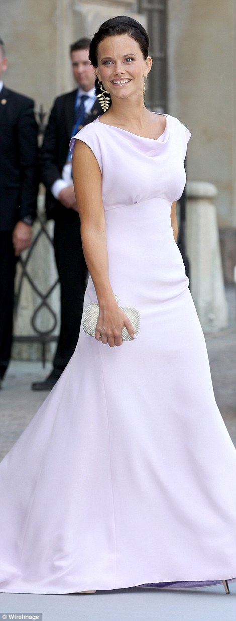 Regal: Her new wardrobe of elegant tailoring and glamorous gowns makes her look every inch the princess