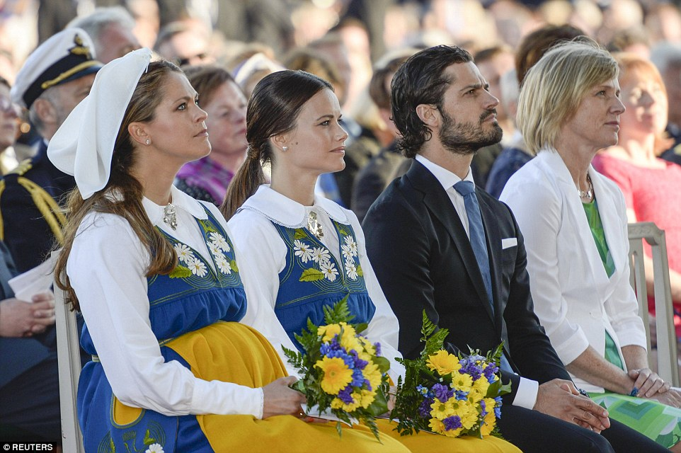 Getting stuck in: Miss Hellqvist with Princess Madeleine (left) and Carl-Philip (right) on National Day