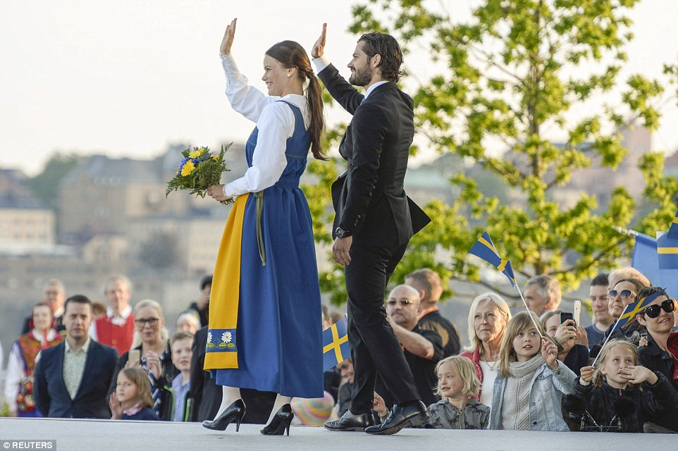 Public role: Miss Hellqvist, who is wearing Swedish National dress, waves to the crowd at Skansen