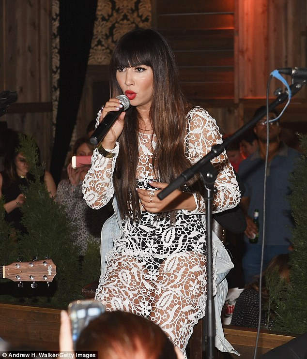 See-through frock: The long-haired 23-year-old - who's of Dominican descent - is currently recording the summer follow-up to her 2010 album Hollywood Gypsy