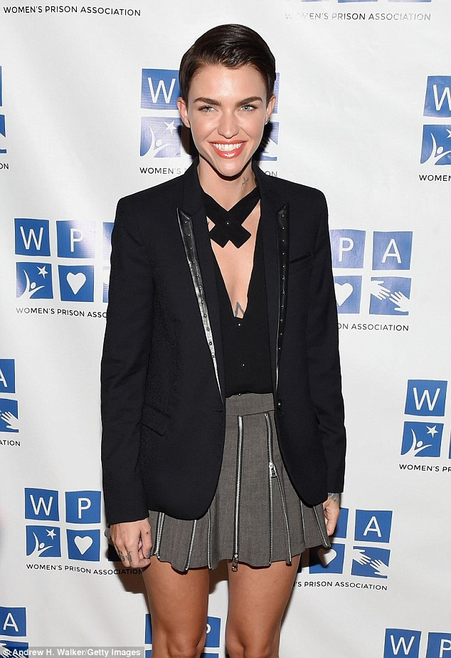 Gorgeous: Also at the charity bash was OITNB newcomer Ruby Rose looking leggy in a naughty schoolgirl ensemble