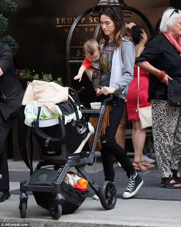 Need a hand? Girlfriend Meagan appeared to have her hands full with a stroller and son Saint