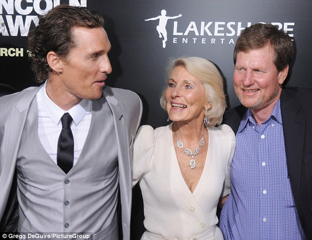 Brotherly love: Matthew McConaughey's brother Michael (pictured right), also known as Rooster, will be starring in his own reality show according to Deadline, as they are pictured with Mary Kathleen McCabe in Hollywood back in March 2011