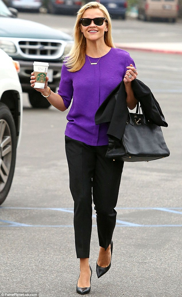 Happy lady: Reese Witherspoon, 39, couldn't wipe the smile off her face as she left a courthouse in Santa Monica on Friday