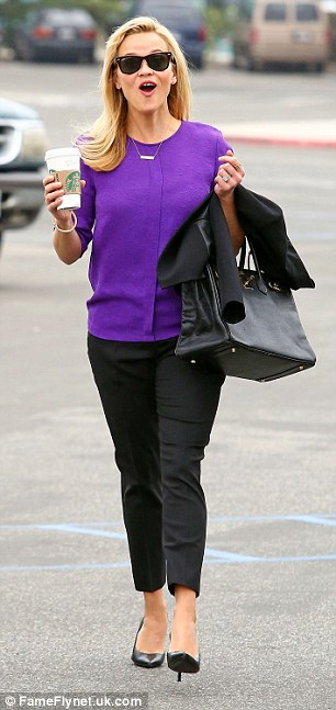Legally blonde: Theactress and model looked radiant in a purple top and smart black trousers