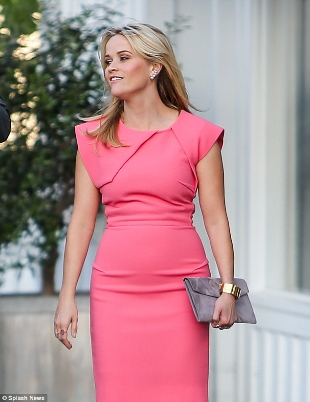 Loosening up: Reese appeared relaxed and rejuvenating in a signature pink dress at an event in Los Angeles on Thursday