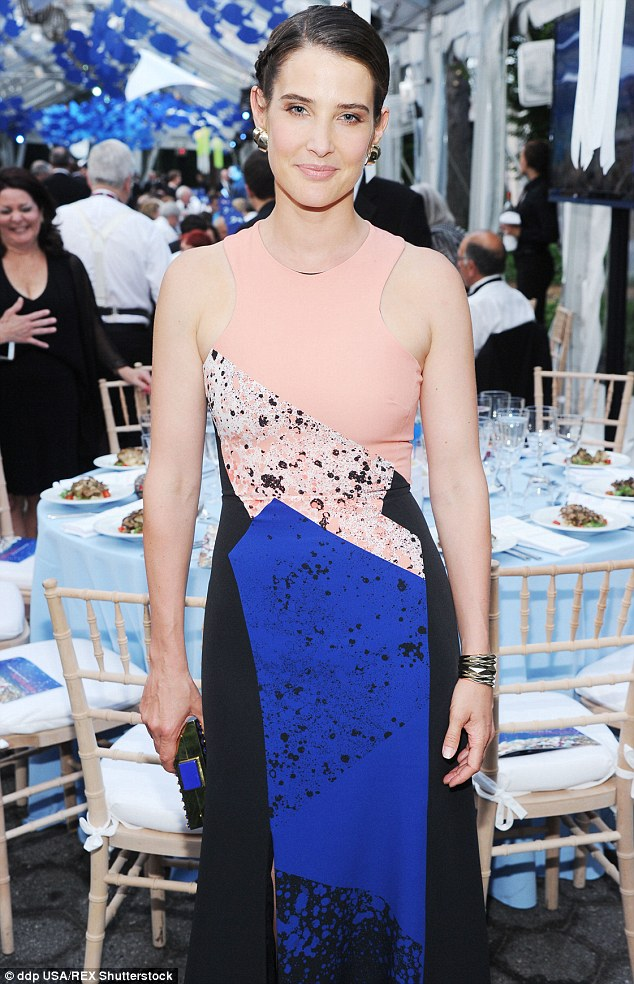 Stunning: The 33-year-old actress'evening gown featured a peach bodice with a blue and black skirt that hugged her every curve