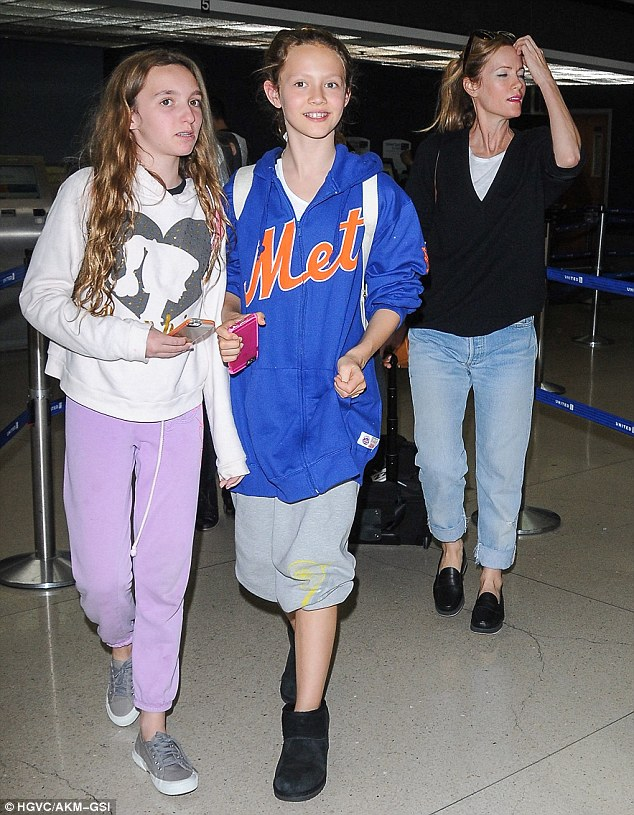 Mother-daughter time: Leslie Mann was seen arriving at Los Angeles International airport with her daughters Iris and Maude Apatow on Friday ahead of a flight