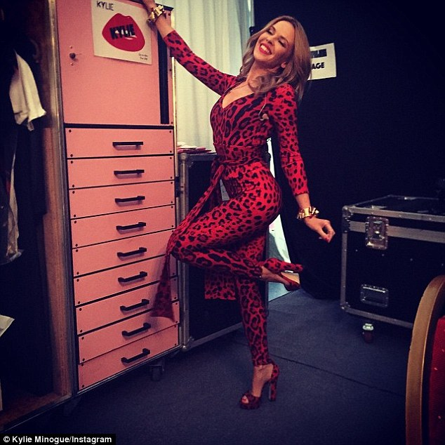 Letting her inner animal out: Kylie Minogue looked flawless in a leopard print jumpsuit on Friday night at the Billetlugen festival in Aalborg, Denmark