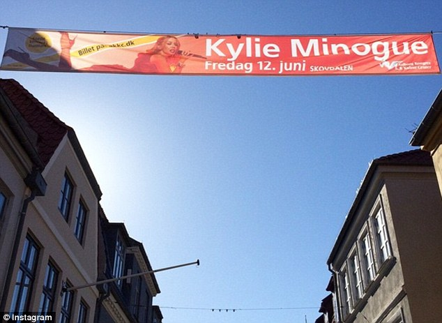 She's here! Kylie took to social media to show off her excitement when she saw her promo sign hanging in the local streets of Denmark